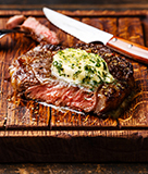 The Benefits of Fat — Rib Eye Steaks with Herbed Butter